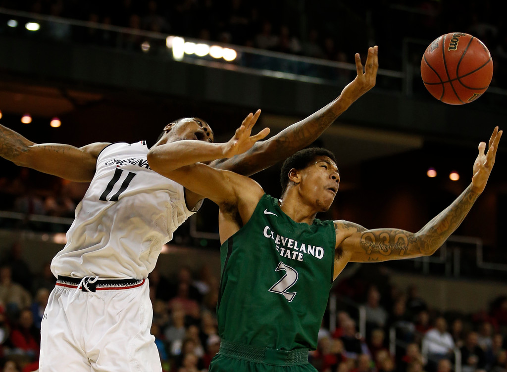 . Cleveland State forward Anthony Wright (2) reaches for a rebound against Cincinnati forward Gary Clark (11) during the second half of an NCAA college basketball game Thursday, Dec. 21, 2017, in Highland Heights, Ky. Cincinnati won 81-62. (AP Photo/Gary Landers)