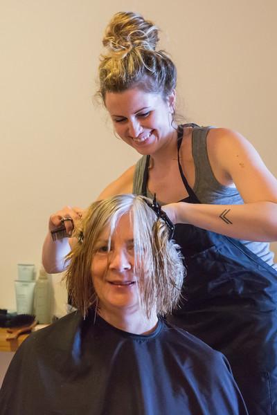 V Kaylee Graham cuts A Sue Clark's hair
