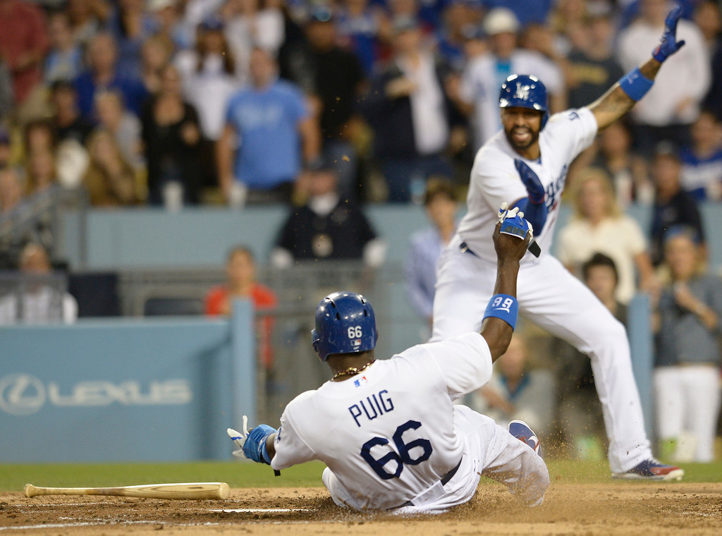 . Dodgers Yasiel Puig slides into home at the urging of Matt Kemp in the 3rd inning. Puig scored off an Adrian Gonzalez double. The Dodgers played the Colorado Rockies at Dodger Stadium in Los Angeles, CA. 6/18/2014(Photo by John McCoy Daily News)