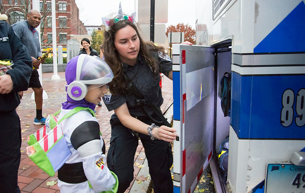 10/31/19 Wesley Bunnell | StaffrrEMT Emily Derynoski shows trick or treater Ryan Stockey, age 4, dressed as Buzz Lightyear the New Britain EMS truck during the New Britain Down District Halloween Safe Zone 2019.