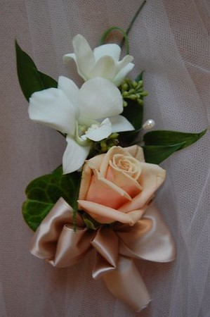 Orchid/rose corsage mix greens  $27-$28