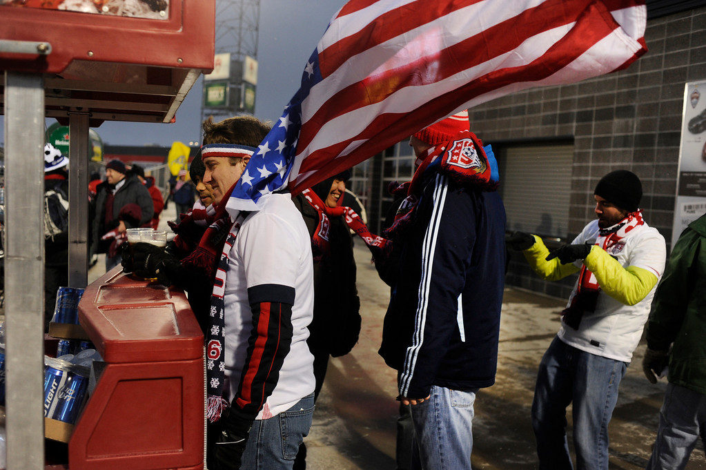 . COMMERCE CITY, CO. - MARCH 22: Dan Baran waited in line to buy a beer as strong winds whipped through Dick\'s Sporting Goods Park before the game Friday night. The U.S. Men\'s National Soccer Team hosted Costa Rica Friday night, March 22, 2013 in a FIFA World Cup qualifier at Dick\'s Sporting Goods Park in Commerce City.  (Photo By Karl Gehring/The Denver Post)