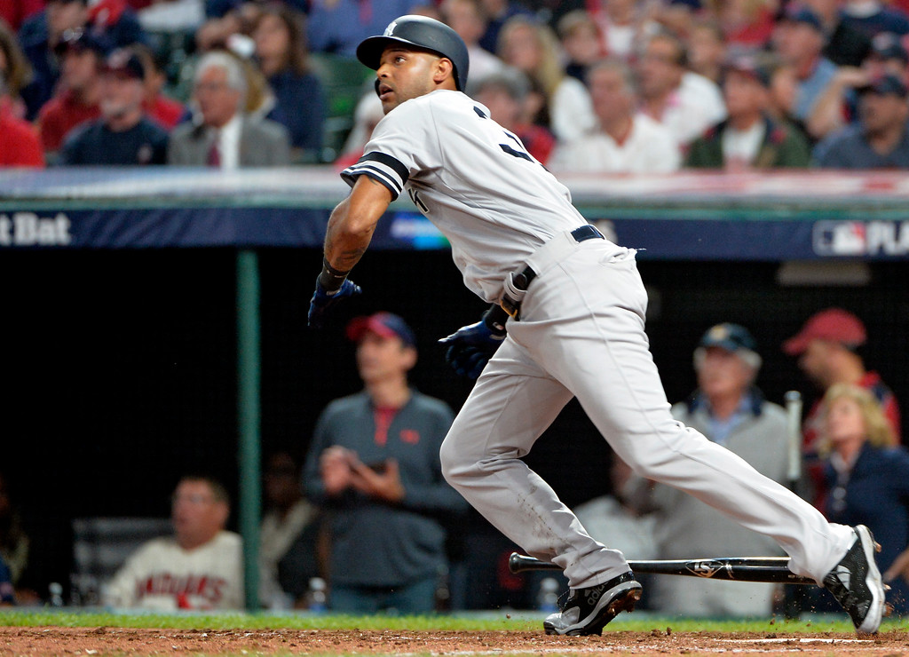 . New York Yankees\' Aaron Hicks watches his ball after hitting a double off Cleveland Indians starting pitcher Trevor Bauer in the sixth inning of Game 1 of baseball\'s American League Division Series, Thursday, Oct. 5, 2017, in Cleveland. (AP Photo/Phil Long)