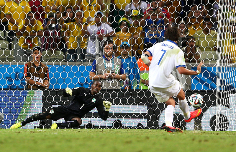 . Giorgos Samaras of Greece scores his team\'s second goal on a penalty kick past Boubacar Barry of the Ivory Coast during the 2014 FIFA World Cup Brazil Group C match between Greece and the Ivory Coast at Castelao on June 24, 2014 in Fortaleza, Brazil.  (Photo by Michael Steele/Getty Images)