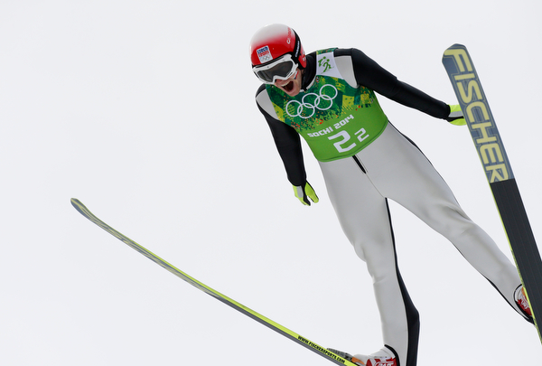 . Czech Republic\'s Tomas Slavik makes an attempt during the ski jumping portion of the Nordic combined Gundersen large hill team competition at the 2014 Winter Olympics, Thursday, Feb. 20, 2014, in Krasnaya Polyana, Russia. (AP Photo/Dmitry Lovetsky)