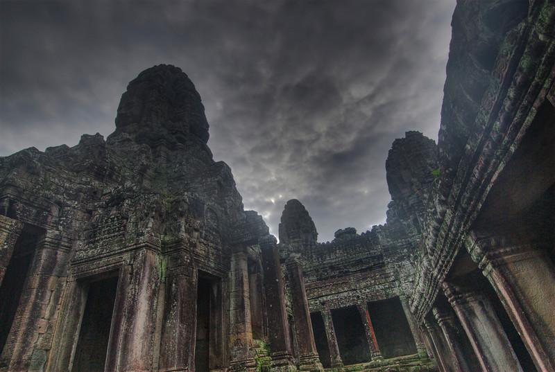 Dark sky engulfing the Bayon Temple in Cambodia