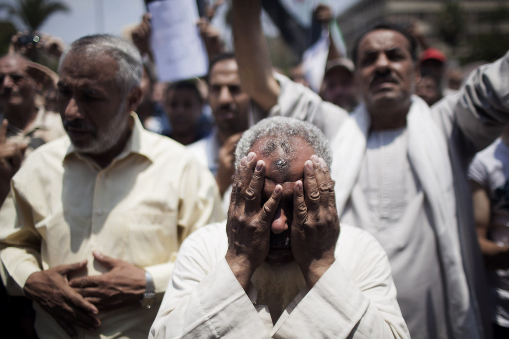 ". An Egyptian protester cries during a demonstration supporting Egypt\'s Islamist President Mohammed Morsi near Cairo University in Giza, Egypt, on Tuesday, July 2, 2013. Egypt was on edge Tuesday following a ""last-chance\"" ultimatum the military issued to Mohammed Morsi, giving the president and the opposition 48 hours to resolve the crisis in the country or have the army step in with its own plan. (AP Photo/Manu Brabo)"
