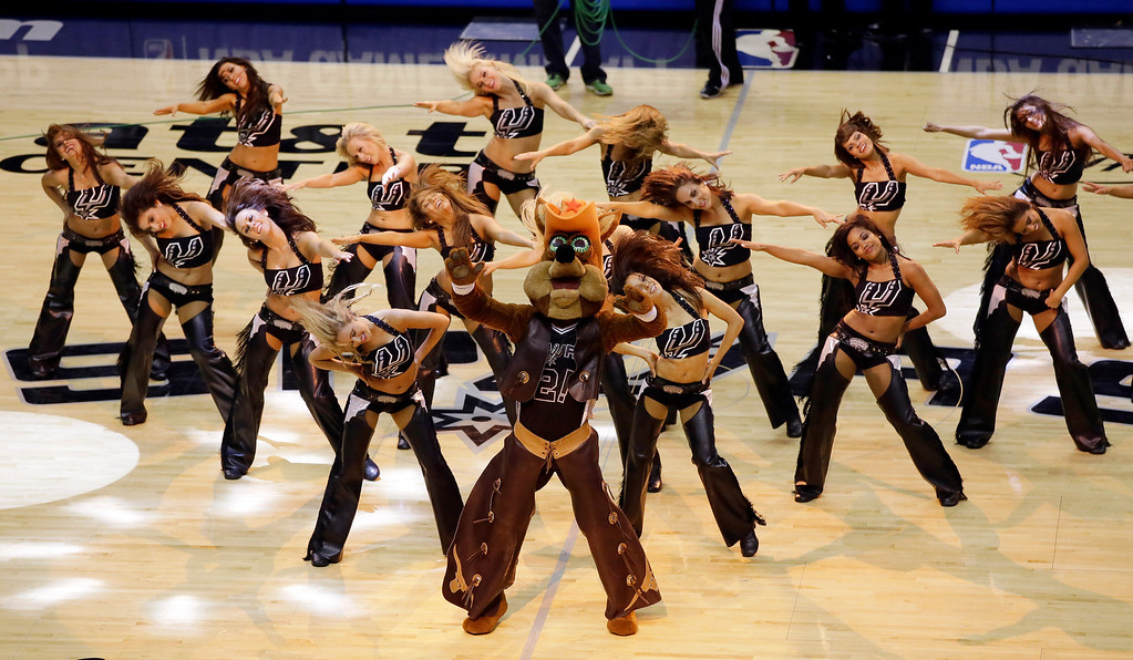 . San Antonio Spurs cheerleaders perform during the first half in Game 1 against the Miami Heatof the NBA basketball finals on Thursday, June 5, 2014, in San Antonio.  (AP Photo/Tony Gutierrez)