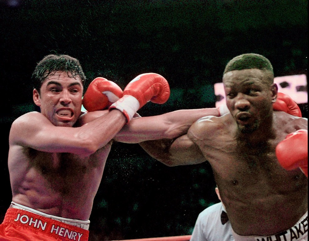 . Oscar De La Hoya and Pernell Whitaker, right, exchange punches during their WBC Welterweight Championship fight at Thomas & Mack Center in Las Vegas, Saturday, April 12, 1997. (AP Photo/Bob Galbraith)