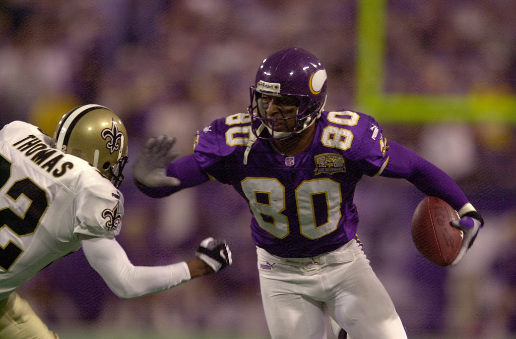. 6 Jan 2001: Cris Carter #80 of the Minnesota Vikings gets past Fred Thomas #22 of the New Orleans Saints for the first down at the Hubert H. Humphrey Metrodome in Minneapolis, Minnesota. The Minnesota Vikings beat the New Orleans Saints 34-16.  Mandatory Credit: Elsa/ALLSPORT