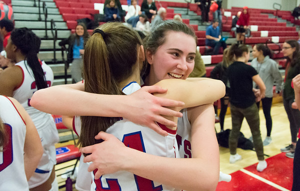 03/01/19 Wesley Bunnell | Staff Berlin defeated Ansonia 54-52 on Friday night. Ashley Wenzel (10) hugs Clare McGeever (21).