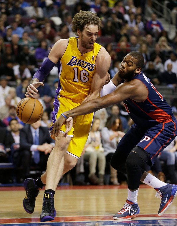 . Detroit Pistons forward Greg Monroe, right, knocks the ball away from Los Angeles Lakers center Pau Gasol (16), of Spain, during the first quarter of an NBA basketball game at the Palace in Auburn Hills, Mich., Friday, Nov. 29, 2013. (AP Photo/Carlos Osorio)