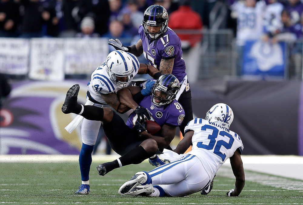 . Anquan Boldin #81 of the Baltimore Ravens catches a pass in the third quarter against Antoine Bethea #41 and Cassius Vaughn #32 of the Indianapolis Colts during the AFC Wild Card Playoff Game at M&T Bank Stadium on January 6, 2013 in Baltimore, Maryland.  (Photo by Rob Carr/Getty Images)