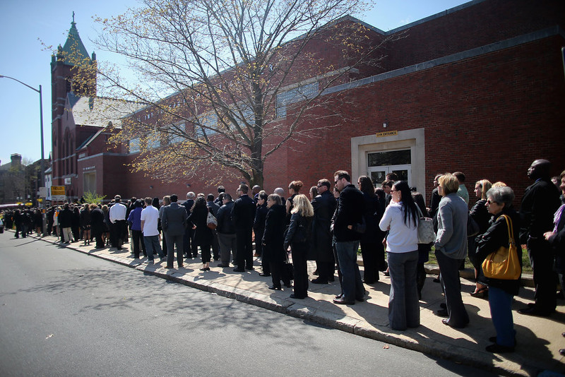 . People wait on line to attend the funeral for 29-year-old Krystle Campbell who was one of three people killed in the Boston Marathon bombings on April 22, 2013 in Medford, Massachusetts. The 29-year-old restaurant manager was raised in Medford. Massachusetts Gov. Deval Patrick has asked residents to observe a moment of silence at the time of the first explosion at 2:50 p.m. this afternoon.  (Photo by Mario Tama/Getty Images)