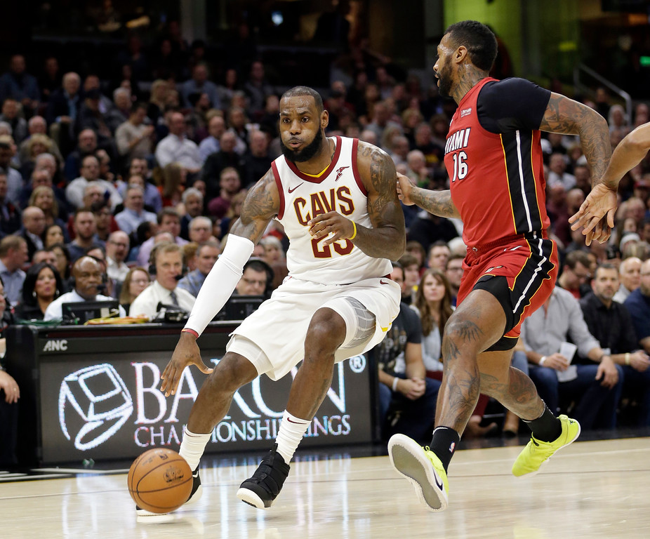 . Cleveland Cavaliers\' LeBron James (23) drives against Miami Heat\'s James Johnson (16) in the first half of an NBA basketball game, Tuesday, Nov. 28, 2017, in Cleveland. (AP Photo/Tony Dejak)