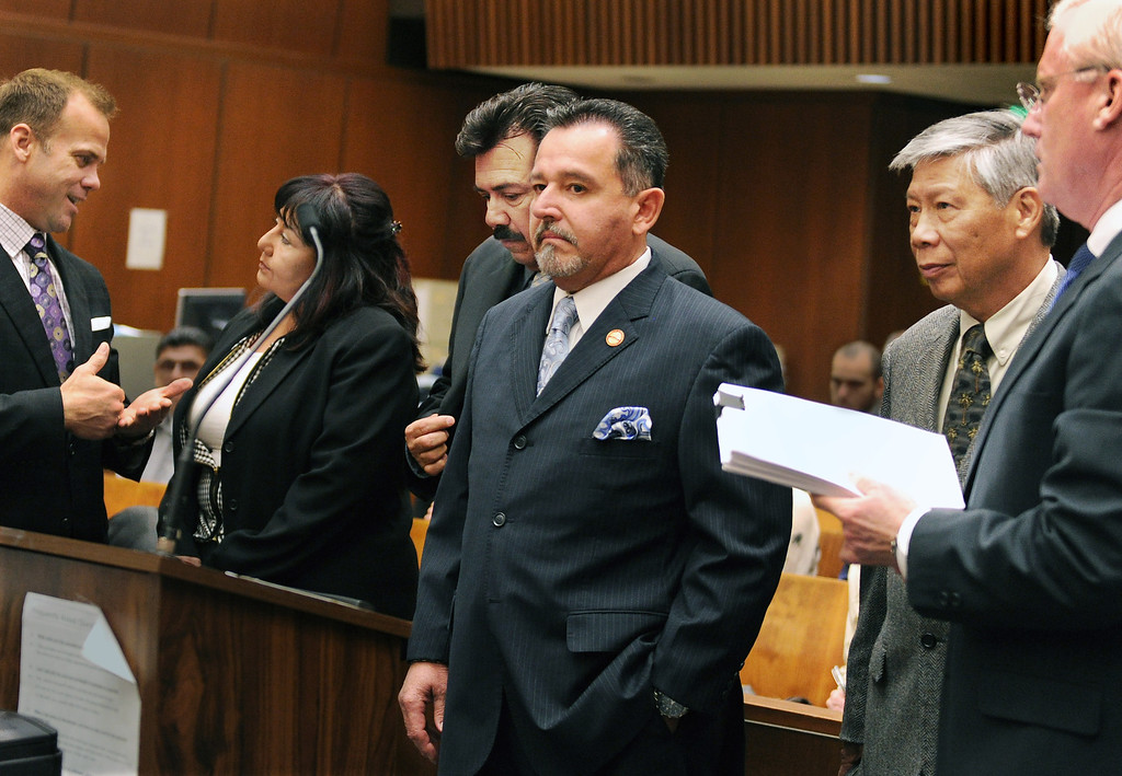 . Former Irwindale Councilwoman Rosemary Ramirez, left,  Councilman, Manuel Garcia,  Mayor Mark Breceda, and Finance Director Abe DeDios with their attorneys at Clara Shortridge Foltz Criminal Justice Center Thursday, February 27, 2014.  Irwindale officials are accused of misappropriation of public funds, conflict of interest and embezzlement spending $200,000 on trips to New York City between 2001-2005.  Their arraignment was postponed once again to April 9, 2014.(Photo by Walt Mancini/San Gabriel Valley Tribune)
