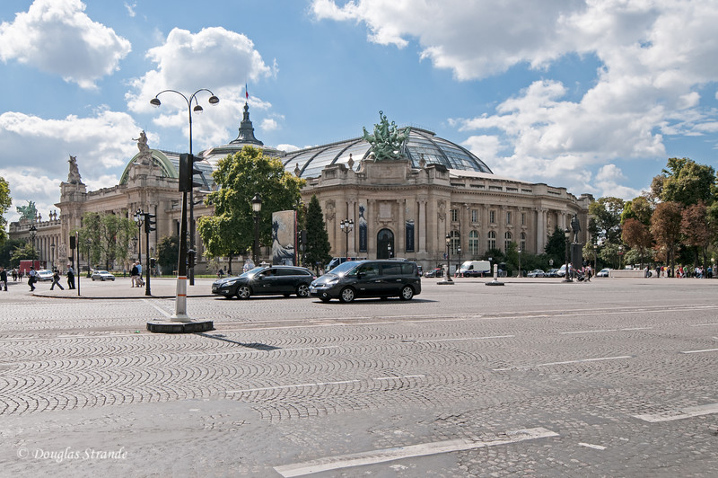 Looking across the Champs-Elysees at the Grand Palais built for the 1900 Exposition