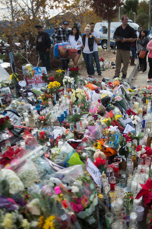 . People pay their respects at a memorial for actor Paul Walker who was killed on Saturday, November 30, 2013 in Valencia, Ca. Walker was a passenger in a 2005 Porsche Carrera GT, believed to be driven by his friend Roger Rodas, that crashed and burst in to flames. (Photo by Hans Gutknecht/Los Angeles Daily News)