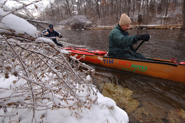 Mike Garon, right, of Washington Township and Bill Schmitz of Commerce Township paddle a racing canoe upstream in the Huron River at the Island Lake Recreation Area Saturday.  With cold temperatures settling in, (21 degrees at noon Saturday) this is one part of the Huron river that never freezes.  They are preparing for the AuSable Canoe Marathon, a 120-mile race that starts in Grayling and ends in Oscoda.     (MARK BIALEK/Special to the Detroit News)