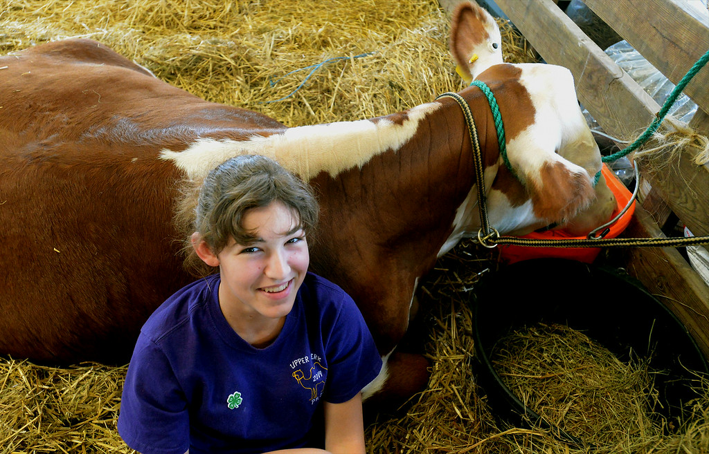 . Lindsay Rodgers hangs out with her blue ribbon steer, Tank, at the Montgomery County 4-H Fair in Creamery Friday, Aug. 8, 2014. Montgomery Media staff photo by Bob Raines
