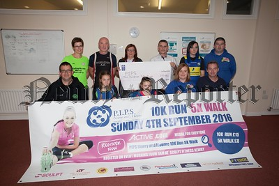 Pictured at the launch of PIPS 10k are Dermot Winders (SGR), Eva Winters, Annie Stewart, Rosemary Stewart, Eamon Murphy, Elaine McCann (Mullaghbawn Road Runners), Colm Devlin (Murlock AC), Fiona McGivern (First Trust Bank), Seamus McCabe, Patricia McMullan (NCR) and Roibeard Stewart. R1632003