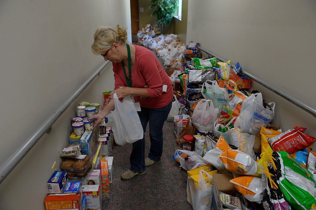 . Volunteer Patty Kee helping stock donations for rescued residents of Lyons being sheltered at the LifeBridge Christian Church in Longmont September 13, 2013 Longmont, Colorado. (Photo By Joe Amon/The Denver Post)