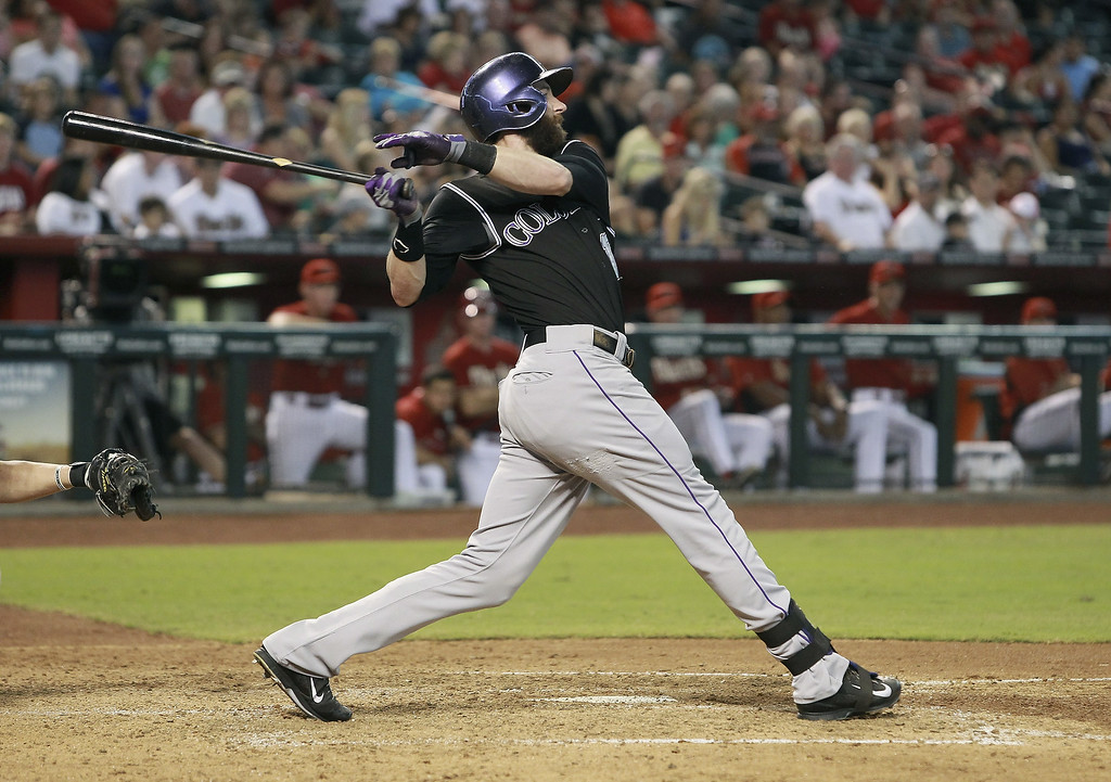 . Charlie Blackmon #19 of the Colorado Rockies hits a deep fly ball against the Arizona Diamondbacks during the fourth inning of a MLB game at Chase Field on August 31, 2014 in Phoenix, Arizona.  (Photo by Ralph Freso/Getty Images)
