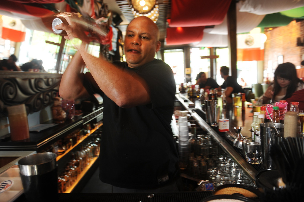 ". Bartender JJ  Ahern shakes the classic margarita  ""El Brazo\"" at the El Camino Community Tavern 3628 W. 32nd Ave in the Denver Highlands  on Wednesday,  April 25, 2012.  Cyrus McCrimmon, The  Denver Post"