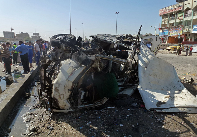 . Iraqis inspect the site of a car bomb explosion in the impoverished district of Sadr City in Baghdad on July 29, 2013, after 11 car bombs hit nine different areas of Baghdad, seven of them Shiite-majority, while another exploded in Mahmudiyah to the south of the capital.  More than 3,000 people have been killed in violence since the beginning of the year, according to AFP figures based on security and medical sources -- a surge in unrest that the Iraqi government has so far failed to stem.  AHMAD AL-RUBAYE/AFP/Getty Images
