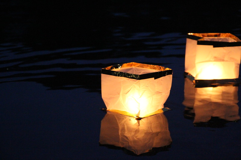 The lanterns floated across the lake after being released by the seniors.