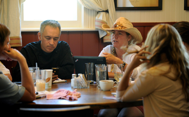 . Summer Love series with Lenny,left,  and Sara Martinelli  (back right) have a staff meeting at the shoot at the  Chautauqua Dining Hall. The couple runs several restaurants in Boulder including the dining hall. (Photo By Cyrus McCrimmon/The Denver Post)