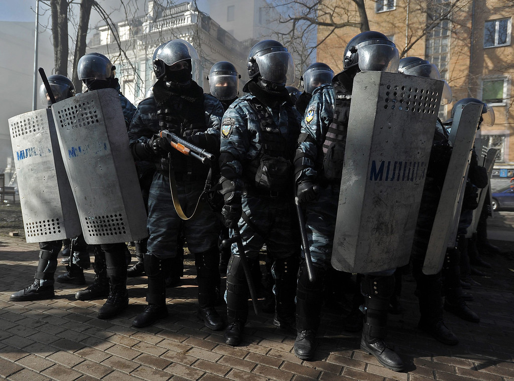 . Riot policemen stand during an anti-government protest in downtown Kiev, Ukraine, 18 February 2014. A least three protesters were killed in clashes with police on 18 February, Ukrainian opposition activists say.  EPA/ALEXEY FURMAN