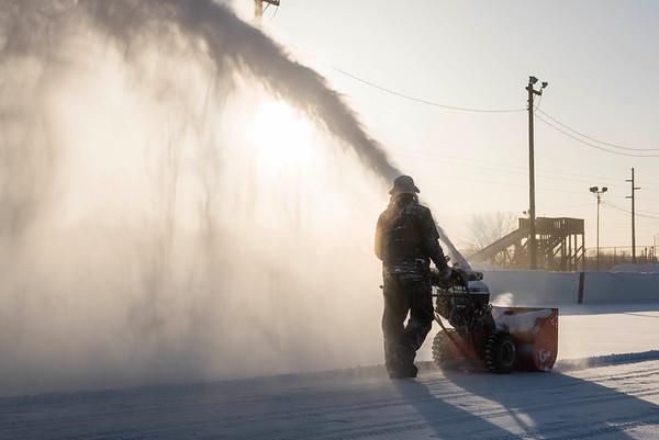 Site Supervisor for Sir John Franklin Community Centre Scott Street snow blows a hockey rink Wednesday January 4, 2016. (David Lipnowski for Metro News)