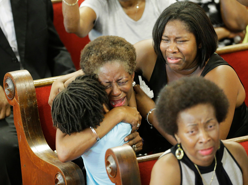 . Parishioners pray and weep during services at the Emanuel A.M.E. Church Sunday, June 21, 2015, in Charleston, S.C., four days after a mass shooting that claimed the lives of it\'s pastor and eight others. (AP Photo/David Goldman, Pool)