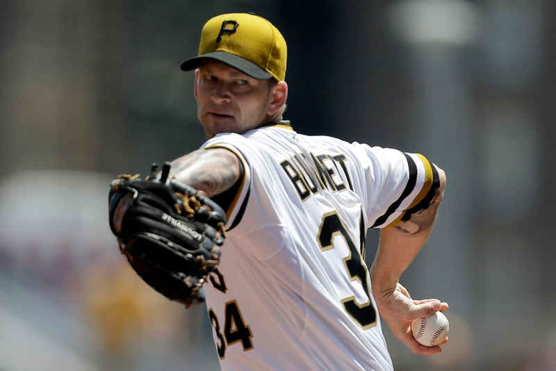 . Pittsburgh Pirates starting pitcher A.J. Burnett (34) delivers during the first inning of an MLB National league baseball game against the Colorado Rockies in Pittsburgh Sunday, Aug. 4, 2013. (AP Photo/Gene J. Puskar)
