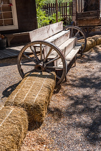 Western bench with wagon wheels