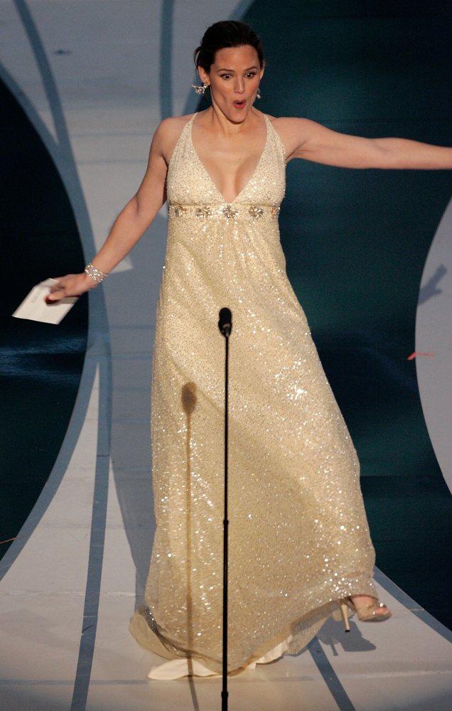 . Actress Jennifer Garner stumbles as she presents the Achievement in Sound Editing award on stage during the 78th Annual Academy Awards at the Kodak Theatre on March 5, 2006 in Hollywood, California.  (Photo by Kevin Winter/Getty Images)