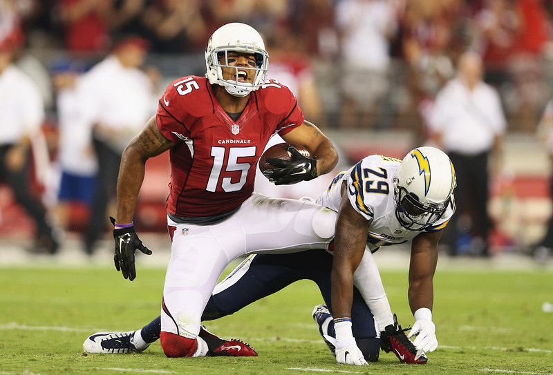 . Wide receiver Michael Floyd #15 of the Arizona Cardinals yells after making a 63 yard reception past cornerback Shareece Wright #29 of the San Diego Chargers in the first quarter of the NFL game at the University of Phoenix Stadium on September 8, 2014 in Glendale, Arizona.  (Photo by Christian Petersen/Getty Images)