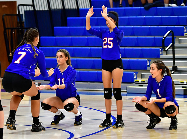 9/27/2018 Mike Orazzi | Staff St. Paul Volleyball's Rebecca Nerbonne (7), Olivia Genovese (11), Violet Rodriguez (25) and Juliette Russo (1) Thursday night in Bristol.