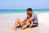 A couple enjoying a beautiful tropical beach.