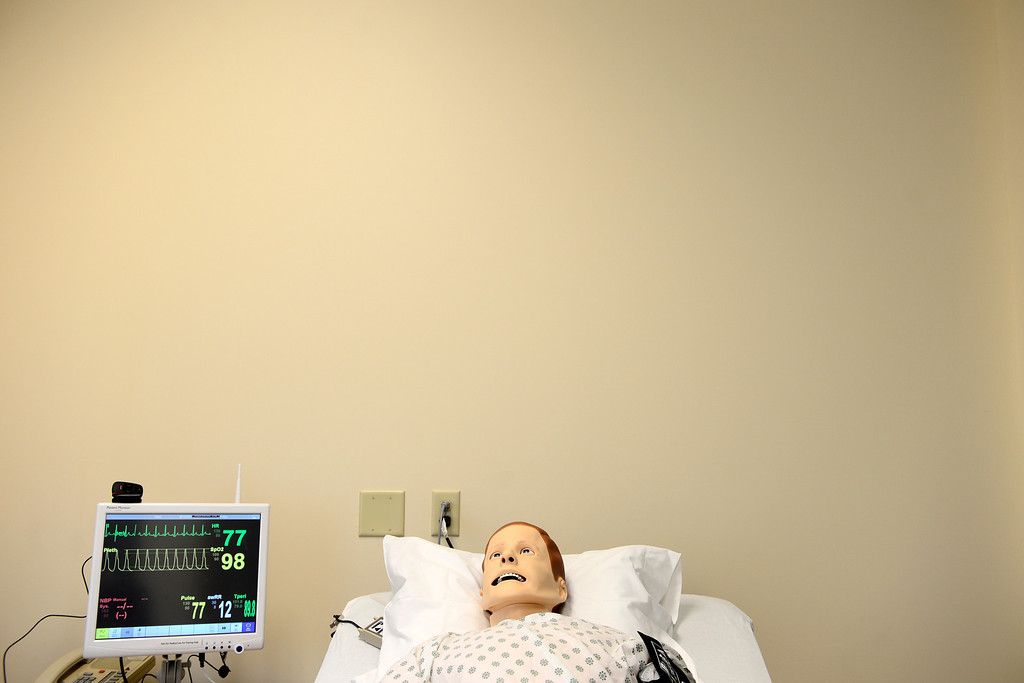 . Sim Man, a high-tech simulation model, lies in a bed in the nursing school at the Emily Griffith Technical College on Thursday, December 6, 2012. AAron Ontiveroz, The Denver Post