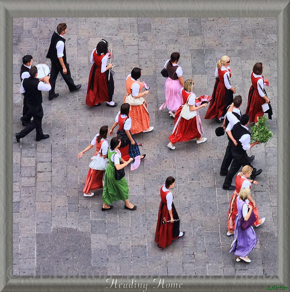 Heading Home A Styrian folk music group heading to their busses after playing in Vienna.