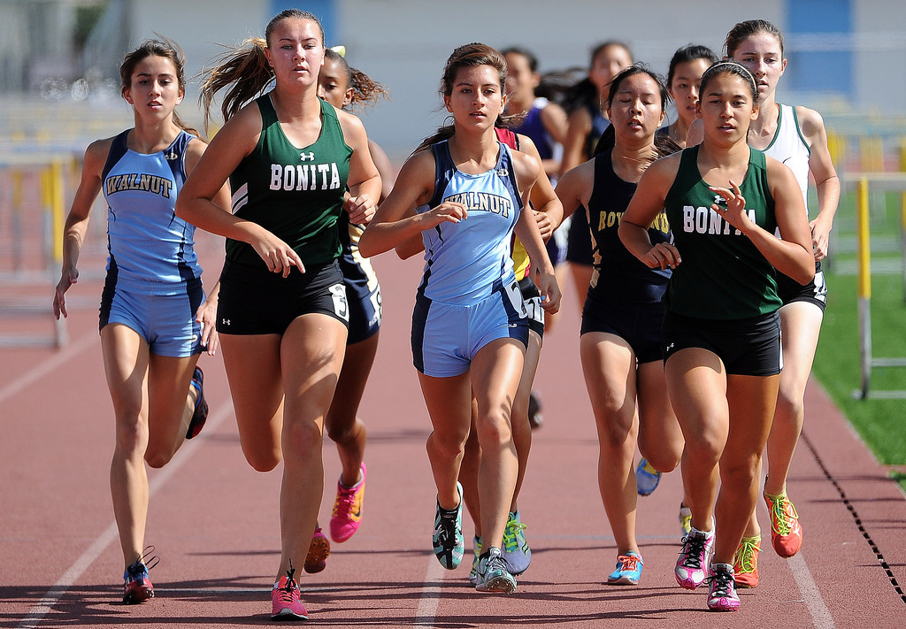 . Bonita\'s Kailyn Scott, right, along with Walnut\'s Jessica Gallardo in the 1600 meter race during the Hacienda League track finals in Walnut, Calif., on Thursday, May 8, 2014.  (Keith Birmingham Pasadena Star-News)