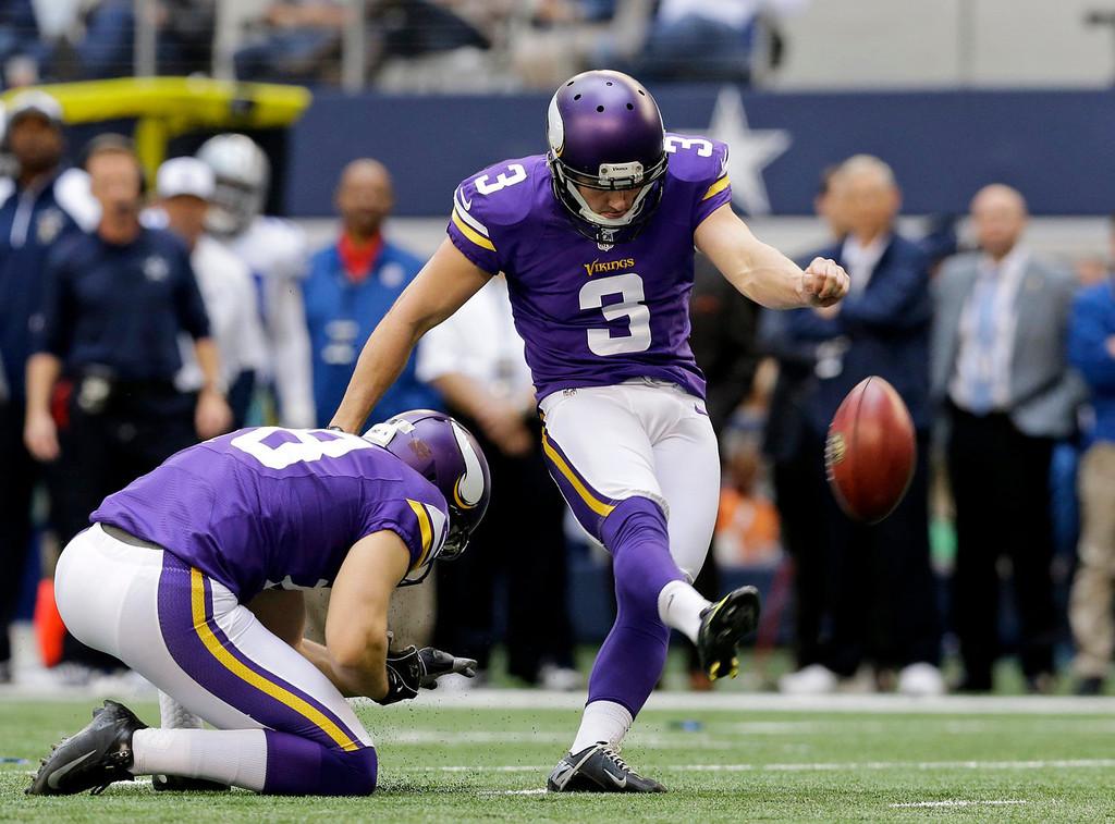 . Minnesota Vikings punter Jeff Locke (18) holds for kicker Blair Walsh (3) as Walsh kicks a field goal against the Dallas Cowboys in the first half of an NFL football game, Sunday, Nov. 3, 2013, in Arlington, Texas. (AP Photo/Nam Y. Huh)