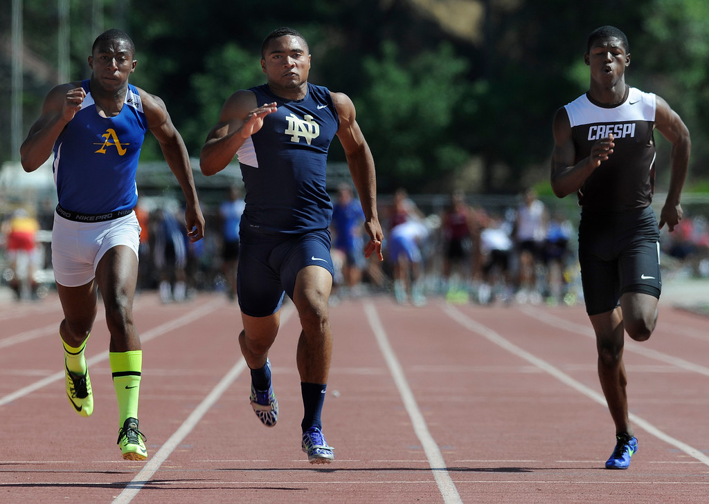 . Khalfani Muhammad from Notre Dame, center, outruns Bishop Amat Darren Andrews and Crespi Tarrick Brock in the 2013 CIF Southern Section Track & Field Divisional Finals held at Mt. San Antonio College in Walnut, CA 5/18/2013(John McCoy/LA Daily News)