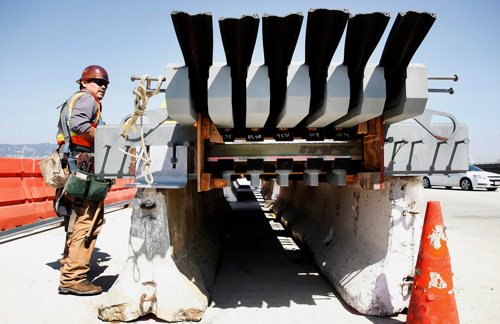. A carpenter works on one of the new Bay Bridge\'s expansion joints that will connect 12 of the span\'s segments, allowing movement of up to 3 feet during an earthquake, on March 1, 2013. (Karl Mondon/Bay Area News Group)