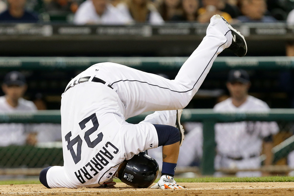 . Detroit Tigers\' Miguel Cabrera tumbles from a inside pitch from New York Yankees relief pitcher Dellin Betances  in the ninth inning of a baseball game in Detroit, Wednesday, Aug. 27, 2014. The Yankees won 8-4. (AP Photo/Paul Sancya)