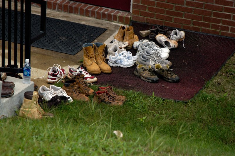 Work shoes come off before entering the church fellowship hall for lunch. cl
