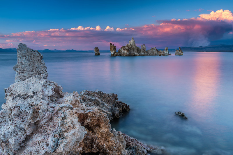 Sunset at the Tufa's in Mono Lake. A fire raged in the background, creating smoke into the sky, also catching the red colors of the setting sun.
