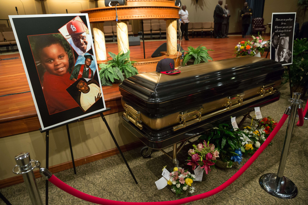 Description of . The casket of Michael Brown is viewed at Friendly Temple Missionary Baptist Church in St. Louis, Missouri on August 25, 2014. Thousands of mourners filled a Baptist church here Monday for the funeral of a black teen whose killing by a white policeman ignited violent protests and debate on race and law enforcement in America. Civil rights leaders and celebrities joined family and friends to pay final respects to Michael Brown, the 18-year-old shot dead in a fatal encounter with police in Ferguson, Missouri, a St Louis suburb, on August 9. Richard Perry/AFP/Getty Images